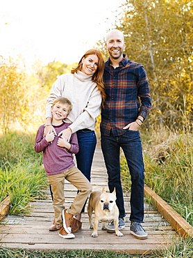 Smiling family on forest boardwalk
