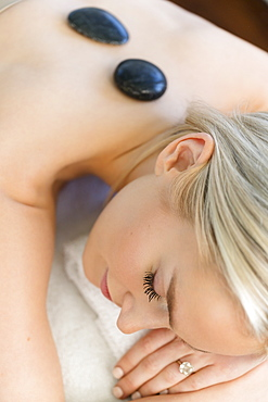 Woman enjoying hot stone massage