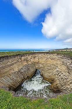 USA, California, San Luis Obispo, Sinkhole at edge of coastal bluff