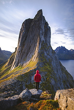 Norway, Senja, Man standing in front of Segla mountain at sunrise