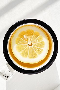 Lemon slice in cup of tea