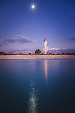 USA, Florida, Boca GrandeLighthouse reflecting in sea at night