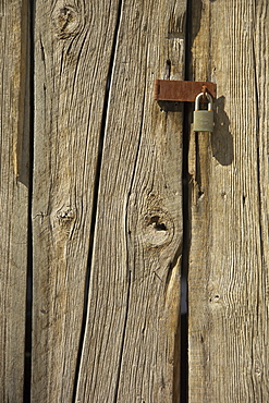 Padlock on a barn door