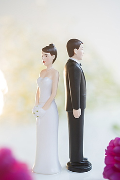 Bride and Groom cake toppers facing away from each other