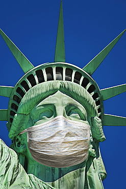 Statue of Liberty wearing protective mask