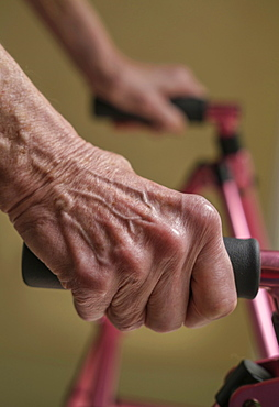 Close up of hands of senior woman on mobility walker