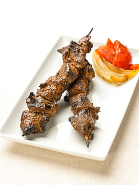 Steak kabob on plate