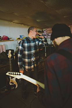Young men during rehearsal in garage