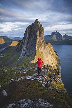 Norway, Senja, Man hiking nearSeglamountain