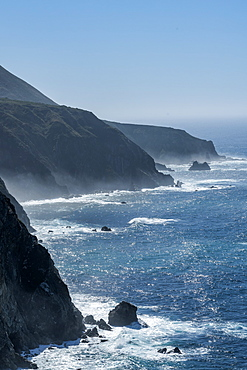 USA, California, Big Sur, Seascape with cliffs and rock formations on sunny day