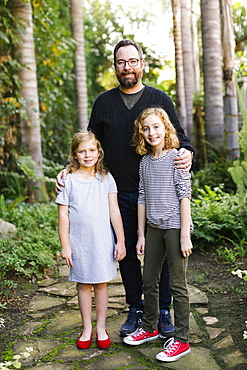 USA, California, Orange County, Portrait of father with daughters (8-9, 12-13)
