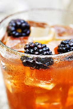 Blackberries in whiskey cocktail