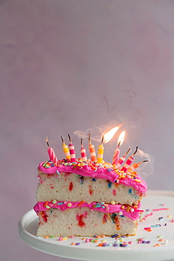 Slice of birthday cake with candles - 1178-29794