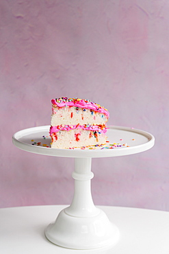 Slice of festive cake on cake stand - 1178-29800