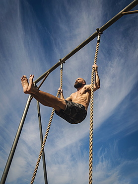 Man exercising on rope