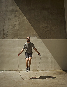 Man exercising with jumping rope