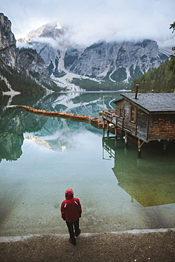 Italy, Man standing at Pragser Wildsee in Dolomites