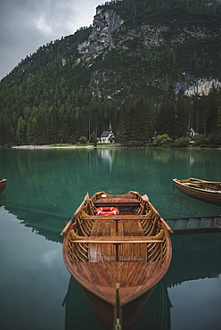 Italy, Wooden boat moored at Pragser Wildsee in Dolomites