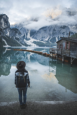 Italy, Woman standing by Pragser Wildsee in Dolomites