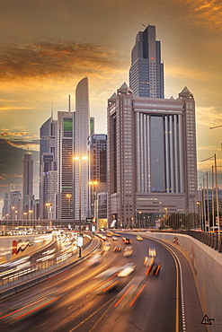 United Arab Emirates, Dubai, Traffic on highway and modern city architecture