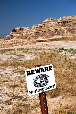 USA, South Dakota, Badlands National Park, Beware of Rattlesnakes sign in Badlands National Park