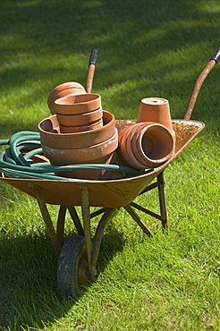 Wheelbarrow and gardening tools