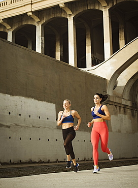 USA, California, Los Angeles, Two sporty women jogging in urban setting