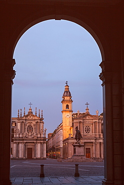 Italy, Piedmont, Turin, Town square with church and statue seen though gate