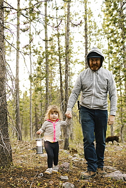 Father with daughter (2-3) walking in forest, Wasatch-Cache National Forest