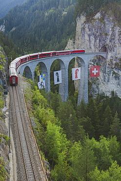 Switzerland, Schmitten and Filisur Landwasser Viaduct, Train on bridge in mountains