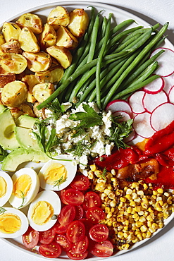 Colorful vegetables, salad and eggs on plate