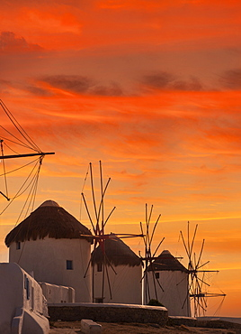 Greece, Cyclades Islands, Mykonos, Chora, Whitewashed windmills against sunset sky