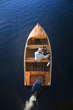 Man in motorboat on Lake Placid