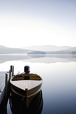 USA, New York, Lake Placid, Motorboat docked on lake