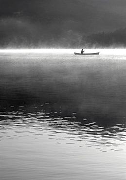 Woman canoeing on Lake Placid Lake
