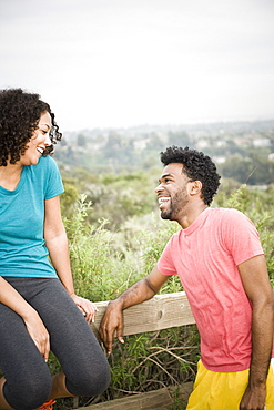 African American man laughing at girlfriend in remote area
