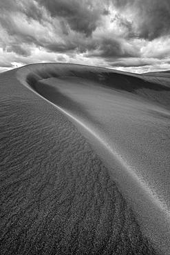 United States, Oregon, Dramatic clouds above sand dune