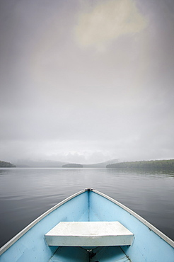 United States, New York, Lake Placid, View from rowboat on foggy lake