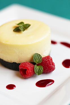 Raspberry cheesecake with fresh raspberries and mint
