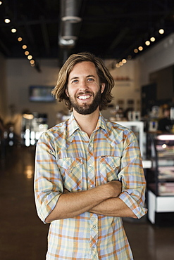 Portrait of mid adult man in coffee shop