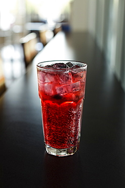 Mixed berry sparkling tea on coffee shop counter