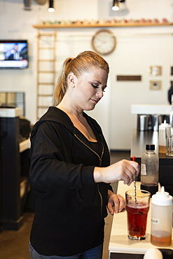 Coffee shop barista making fruit tea