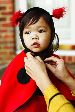 Girl wearing ladybird costume