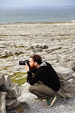 Man taking photograph, The Burren, County Clare, Ireland