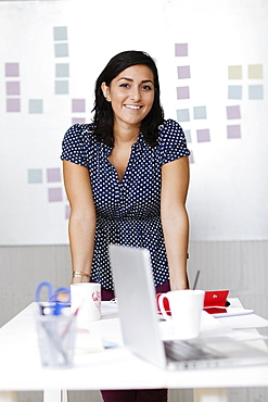 Woman in office of Small Business, Start-up