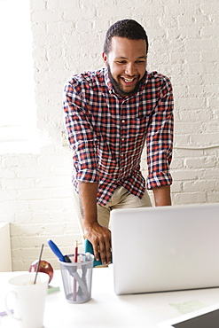 Man with laptop in Small Business, Start-up