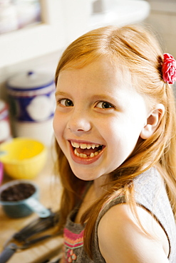 Portrait of smiling girl in kitchen