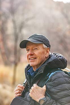 USA, Utah, Escalante, Senior man hiking in Grand Staircase-Escalante National Monument