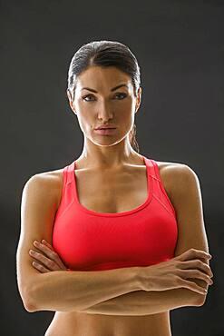 Studio portrait of woman in sports bra