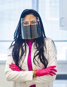 Portrait of female doctor wearing face mask and face shield